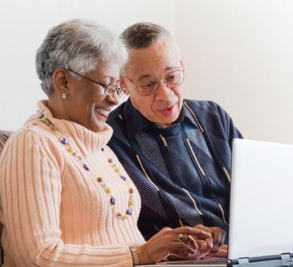 Senior couple looking at laptop