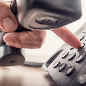 Image of Phone and Hand Dialing
