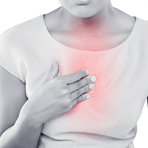 Image of Woman with Hand on Chest Due to Pain