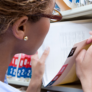 receptionist looking at medical records