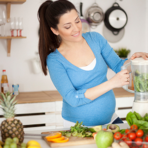 Image of pregnant mother preparing food