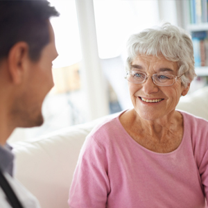 senior woman smiling at doctor