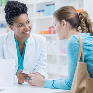 Image of Pharmacist Speaking to Female Customer