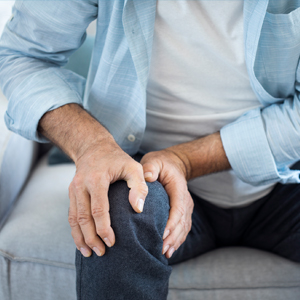 Image of Man Holding Knee Due to Pain