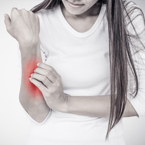 Image of Girl Rubbing Arm Due to Pain