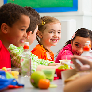 Kids eating at lunch table