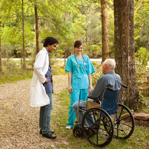 Hospice care team outdoors with patient