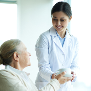 nurse serving woman coffee