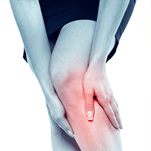 Image of woman holding sore leg