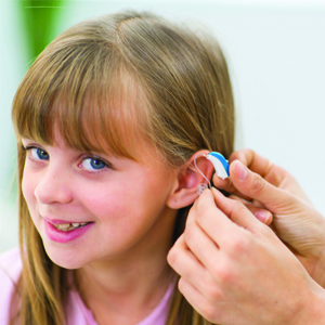 kid with hearing aid