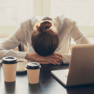 Image of woman tired at desk