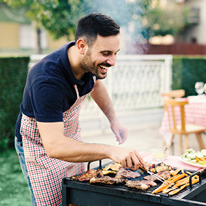 Image of Man Cooking on Barbeque