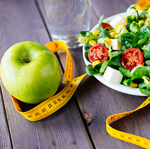Measuring Tape with Apple and Salad