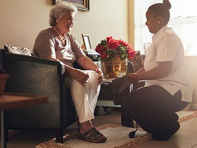 Caregiver providing care to grandfather.