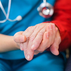 Doctor holding patient's hand