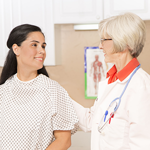 Doctor talking to smiling lady patient