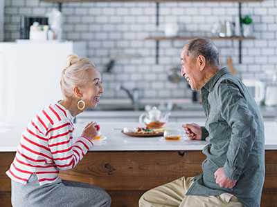 Elderly couple having coffe.