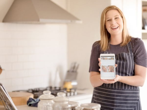 female-food-blogger-in-apron-showing-a-digital-tablet-with-her-picture-id1091555728 (1)