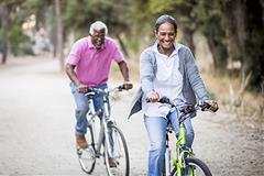 Happy couple on bikes
