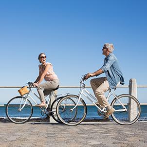 Happy couple riding their bikes
