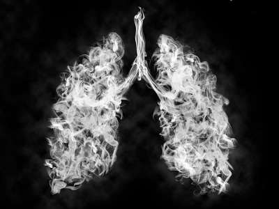 illustration-of-a-toxic-smoke-in-lung-cancer-or-illness-concept-picture-id1179207088