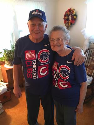 Janice and Terry in Chicago Cubs shirts.