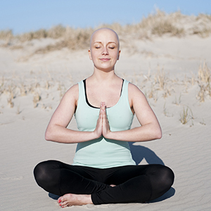 Lady on beach meditating