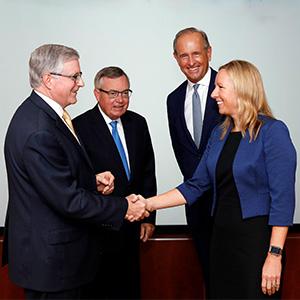 Executives shake hands