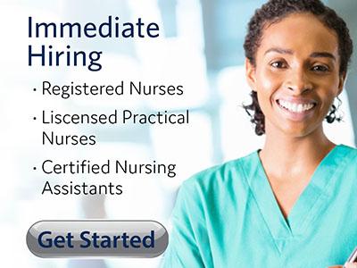 Nurse in blue scrubs.