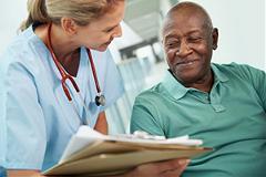 Nurse talking to happy patient
