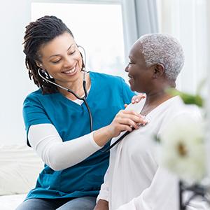 nurse listening to patient heart