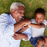 grandfather plays with grandson