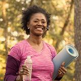 Image of woman with bottle of water and exercise mat