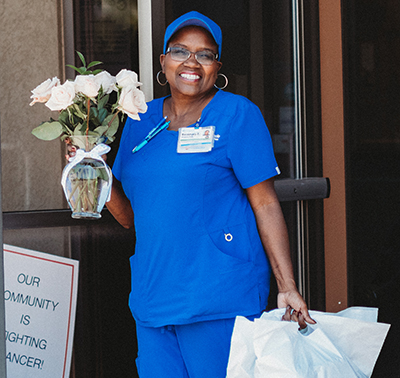 Hospice CNA takes flowers to patients at Caring Circle.