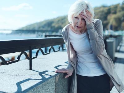 senior-woman-having-vertigo-outdoors-picture-id936488050