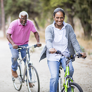 Two smiling seniors on a bike ride