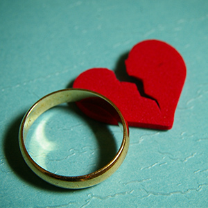 wedding ring and broken heart