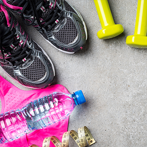 Image of Sneakers, set of small dumbbell weights and water bottle