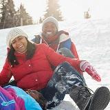 Image of family sledding