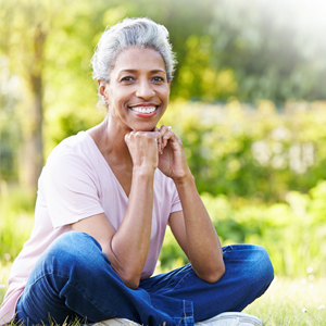 Image of a woman in a park smiling