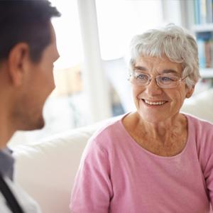senior woman smiling at doctor
