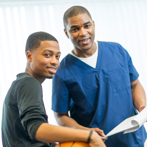 young man getting sports exam with doctor