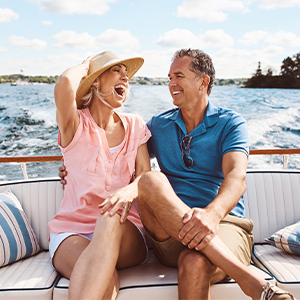Couple laughing on boat