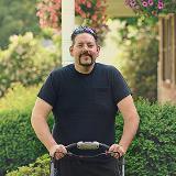 Aaron Wolfe mowing lawn